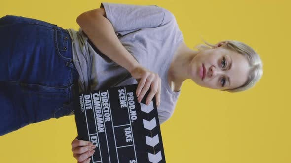 Thumbnail for Bored Woman Clapping Clapperboard