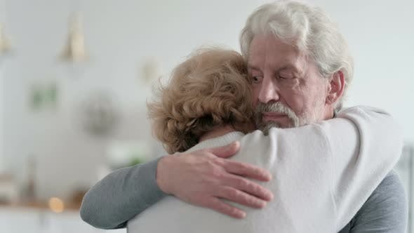 Man Hugging and Consoling Crying Partner