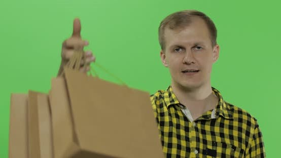 Thumbnail for Young Man on Green Screen Chroma Key Background with Shopping Bags