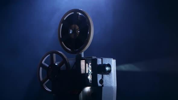 Film Rotates Reels and Vintage Shows Movie. Smoky Dark Studio