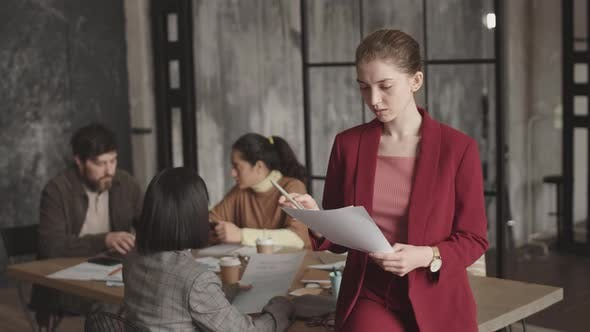 Businesswoman Posing in Conference Room