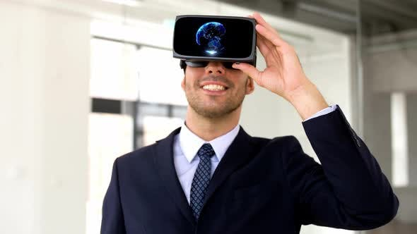 Thumbnail for Businessman in Vr Headset with Earth Projection