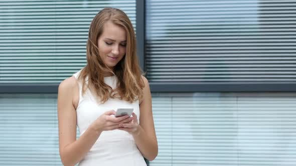 Thumbnail for Text Messaging on Smartphone by Beautiful Girl, Outside Office
