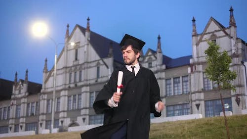 Male Student in Academic Gown Dancing