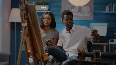 African American Young People Working on Canvas