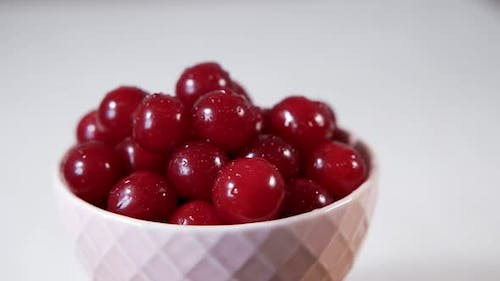 White Cup with Ripe Fresh Cherries