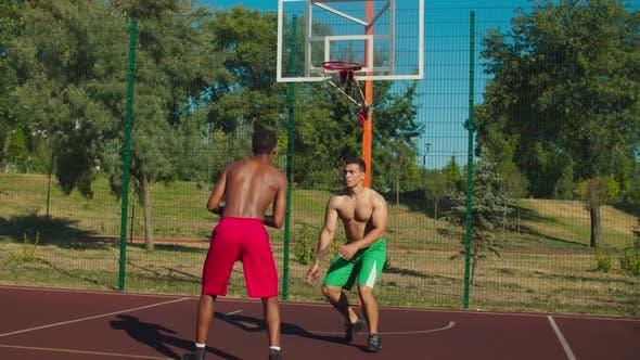 Basketball Players Making Handshake After Match