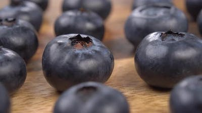 Fresh blueberries on a wooden texture.