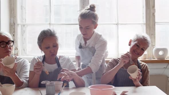 Thumbnail for Female Ceramist Helping Women in Art Studio