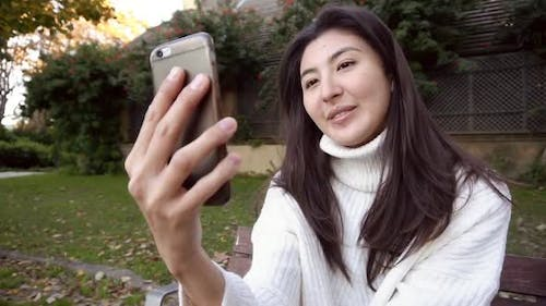 Young Asian Business Woman Looking at Camera or Webcam Talking for Online Job Interview Making