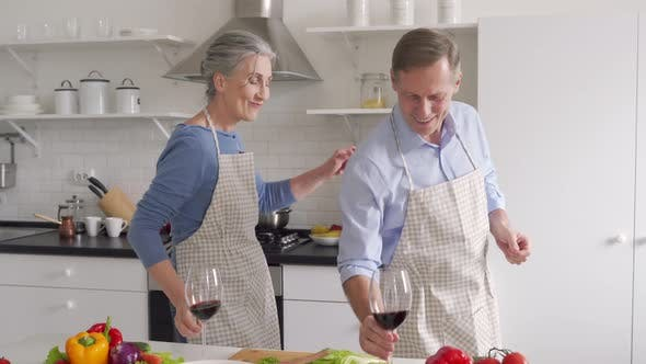 Happy Older Couple Having Fun Dancing Drinking Wine Celebrating Valentines Day