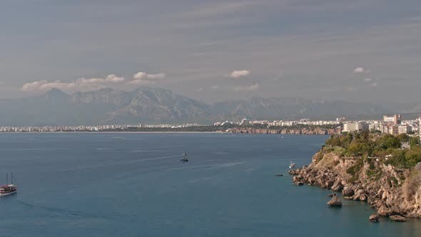 Cover Image for Timelapse of Picturesque Seascape with Mountains and City Coast of Antalya