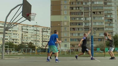 Handsome Streetball Player Doing Reverse Layup