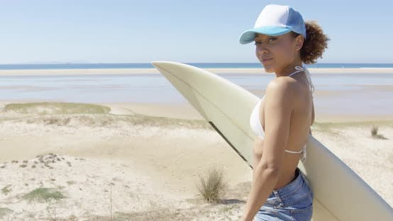 Thumbnail for Smiling Sporty Woman Surfboard