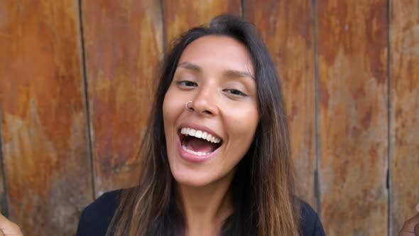 Thumbnail for Beautiful Multiracial Brunette Woman With Lollipops Smiling Outdoors