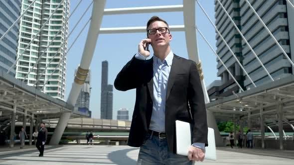 Thumbnail for Entrepreneur Talking On Phone At Modern City