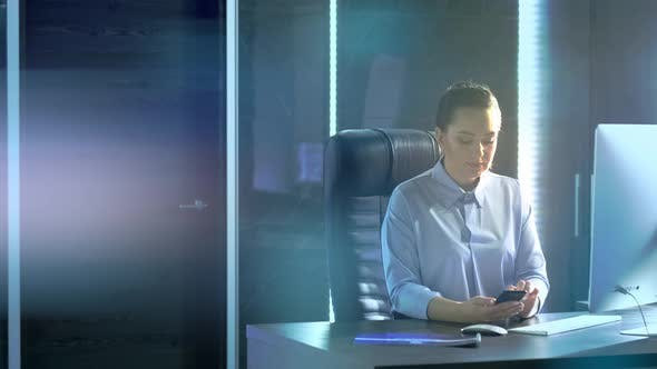 Thumbnail for Woman in Business Office Uses Smartphone for Social Networks