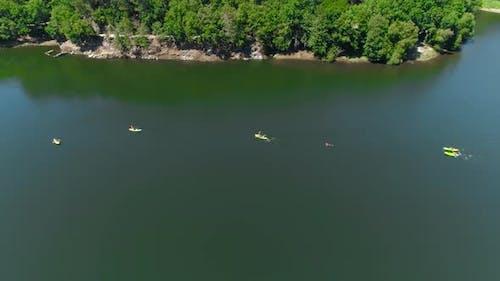People kayaking in lake 4k