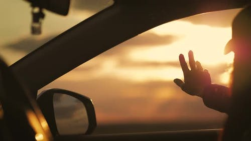 Female Hands of a Car While Driving