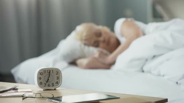 Thumbnail for Beautiful Middle-Aged Lady Sleeping in Bed. a Moment Before Awakening. Health
