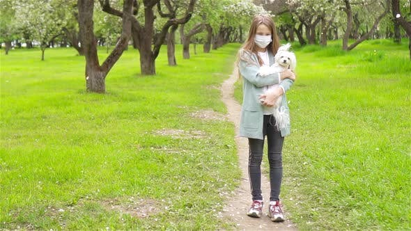 Thumbnail for Little Girl with Dog Wearing Protective Medical Mask for Prevent Virus Outdoors in the Park