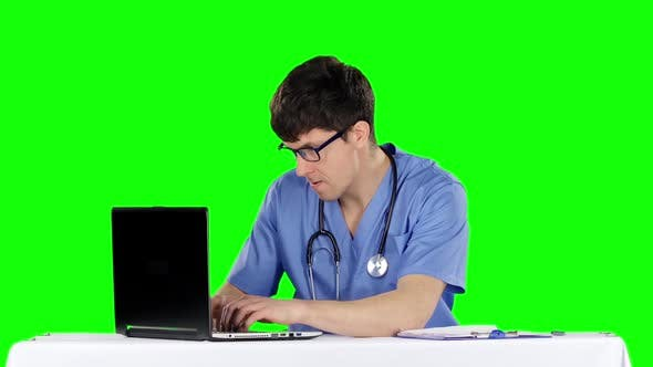 Thumbnail for Angry Doctor Posing at Table. Green Screen