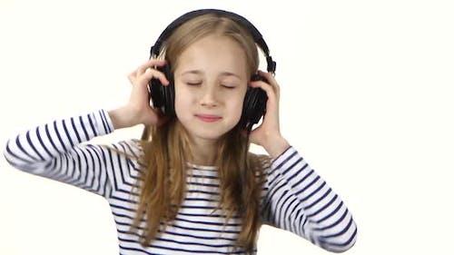 Teenager Girl Listens Music on Headphones and Dances, Close Ups