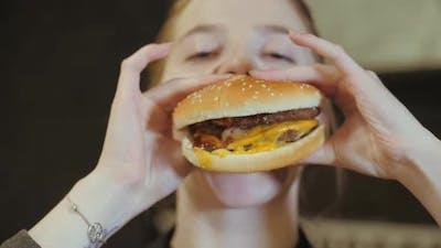 Young Woman Bites Fun at the Burger