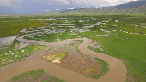 View of river flooding through valley landscape
