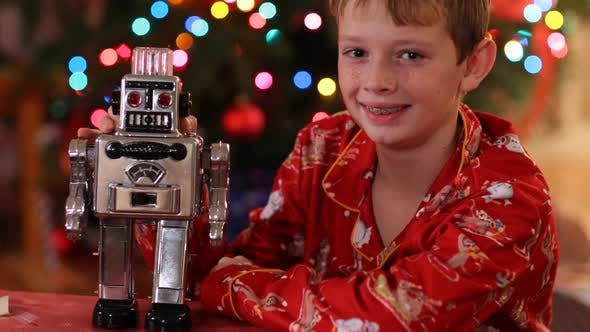 Thumbnail for Portrait of boy with robot on Christmas