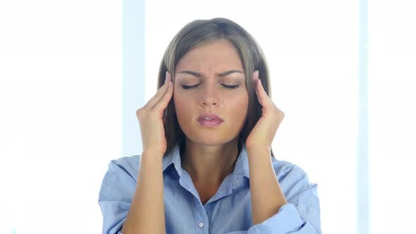 Thumbnail for Portrait of Young Woman Gesturing Headache, Stress