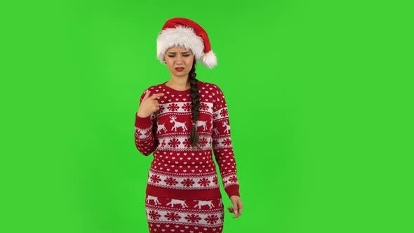 Thumbnail for Sweety Girl in Santa Claus Hat Is Outraging and Refusing, Gesticulating with Hands. Green Screen