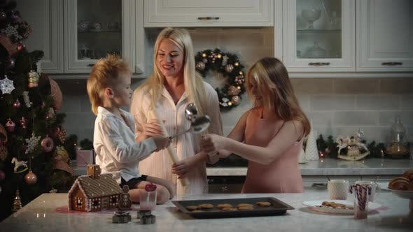 Thumbnail for Family Christmas  Mother and Her Children Making Cookies in Kitchen  Kids Playing with Ladles