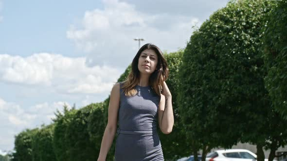 Thumbnail for Successful Businesswoman Walking along Avenue in the City