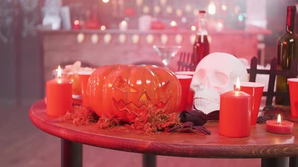 Thumbnail for Jack-o-lantern Halloween Symbol on a Table with a Skull and Candles