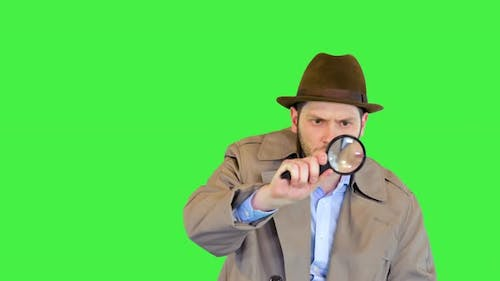 Officer or Retro Private Detective Investigating Crime Looking for Evidence with Magnifying Glass on