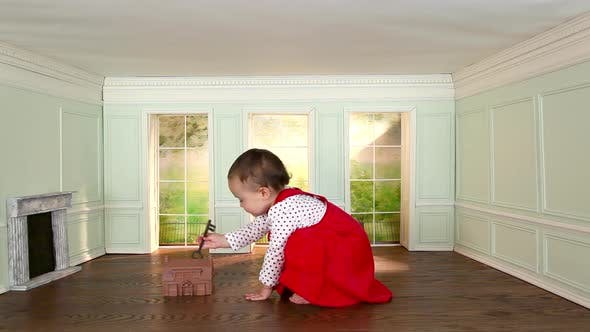 Thumbnail for Toddler girl in small room with model house and key