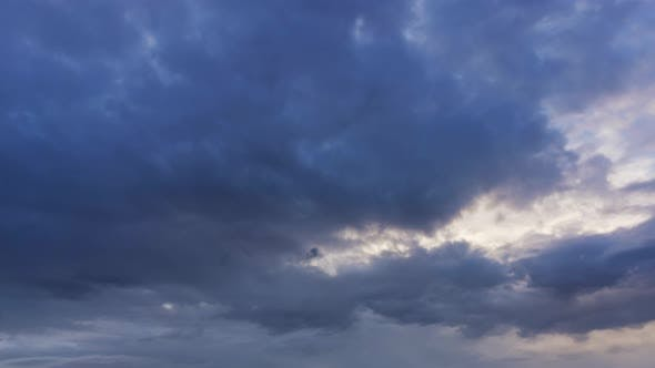 Thumbnail for Timelapse with Dramatic Sunset on Dark Cloudy Sky