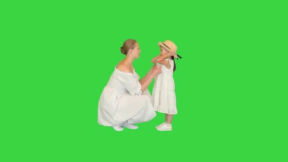 Mother and Daughter Talking with Each Other on a Green Screen Chroma Key
