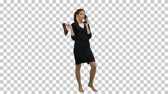 Young chatty woman using a shoe like a telephone, Alpha Channel