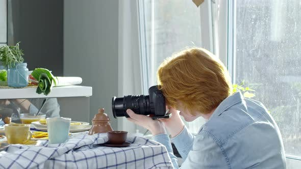 Thumbnail for Man Photographing Food