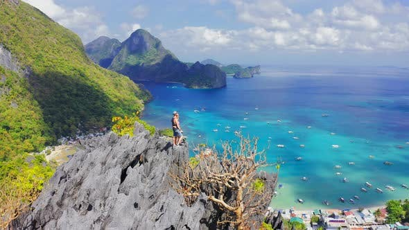 Thumbnail for Hikers Couple Standing on Top of a Mountain and Enjoying Blue Lagoon Bay View in El Nido, Palawan