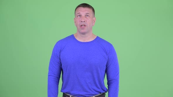 Thumbnail for Stressed Macho Mature Man Looking Bored and Tired
