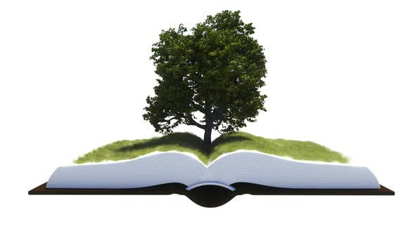 A Tree And Grass Grow Out Of The Pages