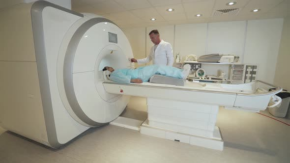 Magnetic Resonance Imaging Adult Professional Doctor Performs a Magnetic Tomographic Examination of