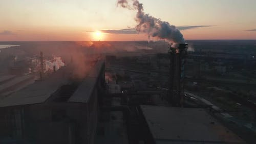 Aerial View. Industry Pipes Pollute the Atmosphere With Smoke.