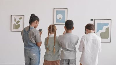 Classmates Taking Pictures of Paintings