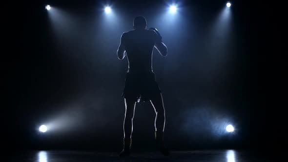 Boxer Develops the Right and Left Hook Rear View