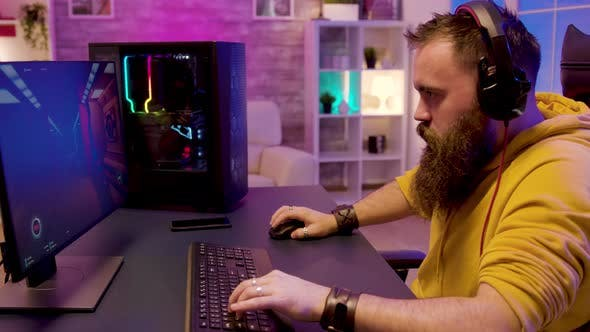 Thumbnail for Hipster Bearded Man Playing Professional Online Games