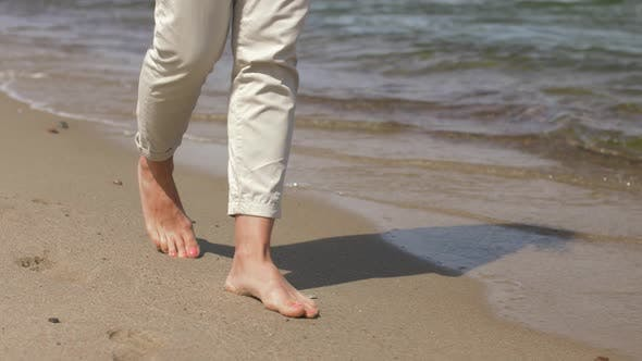 Thumbnail for Woman Feet Walking Barefoot Along Summer Beach 8